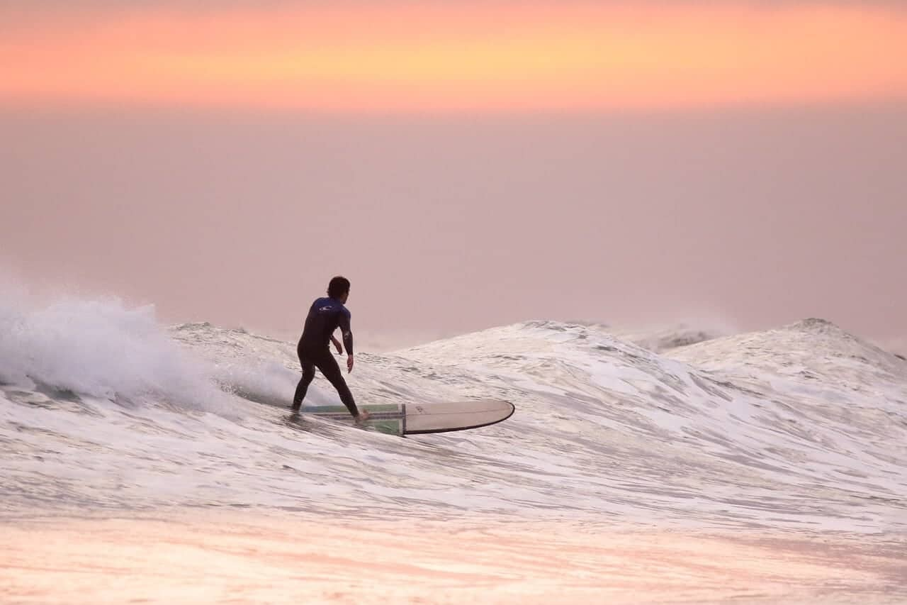 sunset surfer hawaii