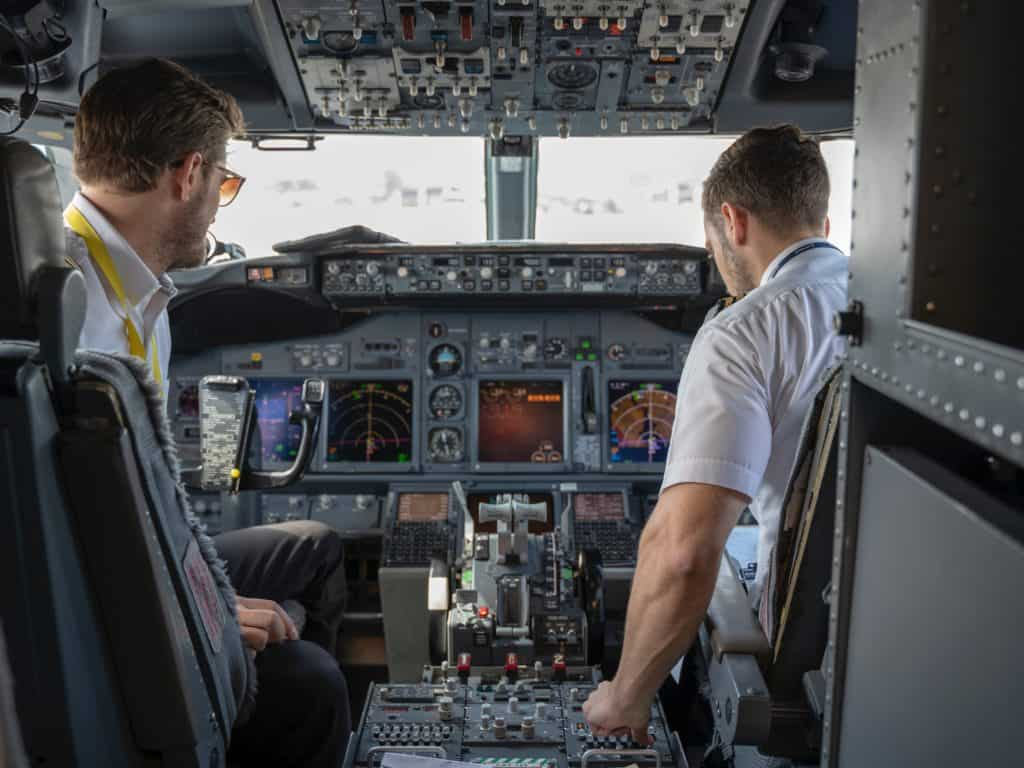 two pilots sitting inside plane 2064123